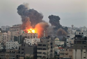 Smoke and fire from an Israeli bomb rises into the air over Gaza City
